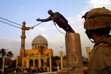 Toppling of the statue of Saddam Hussein. The invasion was sparked by a belief Saddam was developing nuclear weapons. This allegation was later proven false.